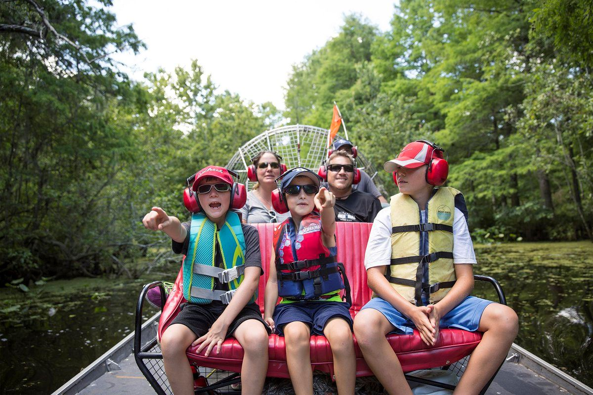 Image of Family enjoying an airboat ride