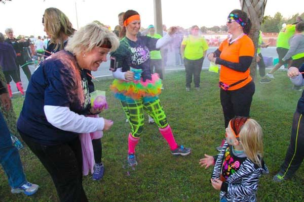 People enjoying each other during the Trick-or-Trot color run.