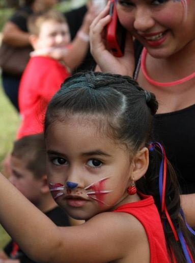 Little girl with face paint during 4th of July celebration.