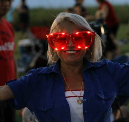 Girl with red light up glasses during 4th of July celebration.